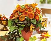 Arrangement of chrysanthemums, straw flowers and hydrangeas