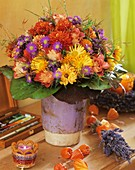 Autumn arrangement of roses, chrysanthemums and asters