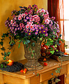 Arrangement of Michaelmas daisies, chrysanthemums, privet berries