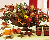 Autumnal arrangement of apples, ornamental apples and quinces