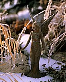 Metal angel with hoar frost