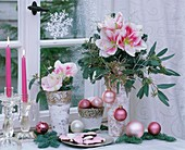 Amaryllises in vases with Christmas decorations