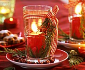 Glass with red candle