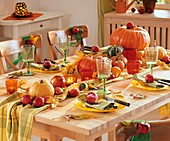 Autumn table decoration with pumpkins