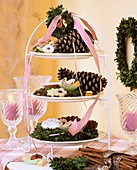 Tiered stand with cones, wreathes and biscuits