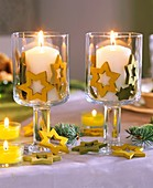 Wine glasses with candles decorated with wooden stars