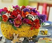 Tulips, hyacinth, anemones & star of Bethlehem in straw basket