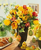 Arrangement of tulips, daffodils & eggs; Easter plait