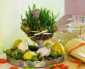 Easter decoration with wheat grass and eggs
