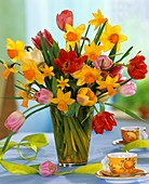Tulips and narcissi in glass vase