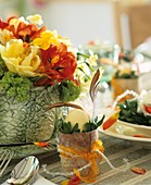 Easter table decoration with flowers and eggcups