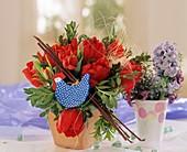 Arrangement of red tulips with wooden chicken