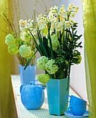 Arrangements of scented narcissi & Viburnum; coffee things