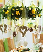 Easter hanging wreath with narcissi, hearts, painted eggs
