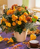 Autumn arrangement of chrysanthemums & ornamental gourds