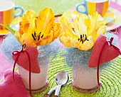 Yellow tulips with blue sisal and pink hearts