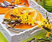 Orange plate with Narcissi, pussy willow and birch twig