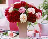 Peonies in vase, gift box and jug