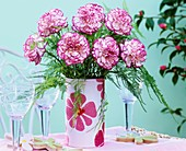 Vase of carnations with pink-edged petals