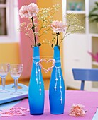 Carnations & Gypsophila in glass vases with heart & pearls