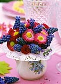 Posy of daisies and grape hyacinths