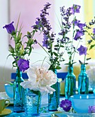 Peony, campanula and catmint in blue bottles