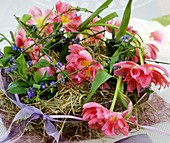 Straw wreath with tulips and forget-me-nots