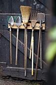 Garden tools on wooden door