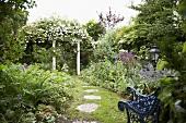 Summery garden with garden seat