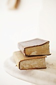 Two old books on a marble slab