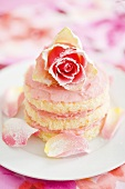 Small sponge cake with yoghurt cream and rose