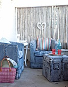 Armchairs and stool covered in jeans fabric