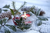 Ice bowl with holly and candle (Christmas decoration for garden)