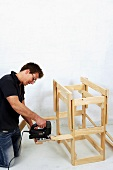 Making wooden folding table (cutting off protruding ends)