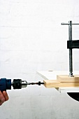 Making a wooden folding table (drilling holes into the ends of slats)