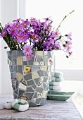 Flowers in mosaic vase