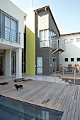 Terrace with wooden decking and pool