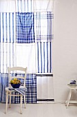 Blue and white curtain (made from tea towels)