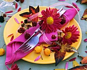 Place-setting decorated with chrysanthemums & crab apples