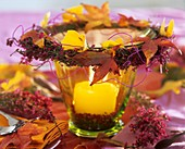 Candle glass with wreath of heather and autumn leaves