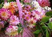 Basket of dahlias and Michaelmas daisies