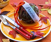 Ball of autumn leaves with name tag