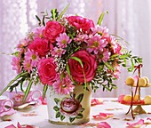 Roses, chrysanthemums and gypsophila in vase