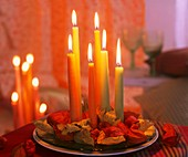Candles on glass plate with Chinese lanterns & autumn leaves