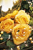 Christmas decoration with yellow roses and beaded wire
