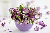 Small bowl of horned violets and lilies-of-the-valley
