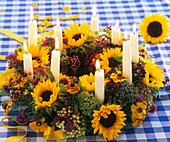 Wreath of sunflowers, helenium, viburnum berries & candles