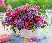 Arrangement of hydrangeas and sweet peas
