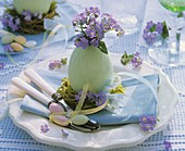 Easter plate decoration with forget-me-nots