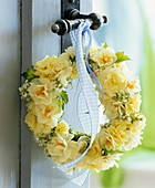 Wreath of narcissi and primulas on door handle